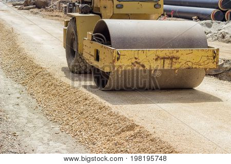 Yellow Vibratory Steel Drum Compactor During Road Construction 2