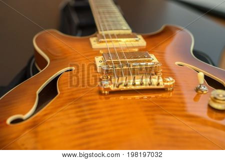 Closeup image with selective focus of retro rock electric guitar