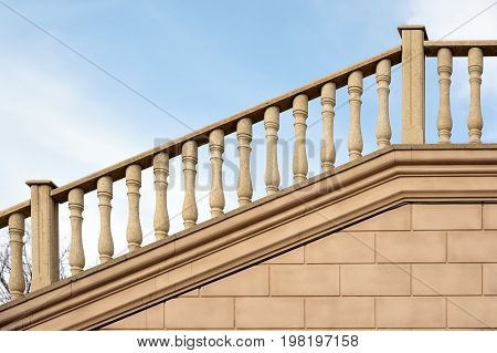 Fragment of modern decorative stone stairs with railings