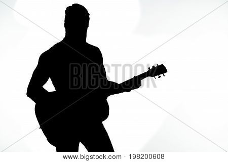 Black Silhouette Of A Man With A Guitar On A White Isolated Background. Horizontal Frame