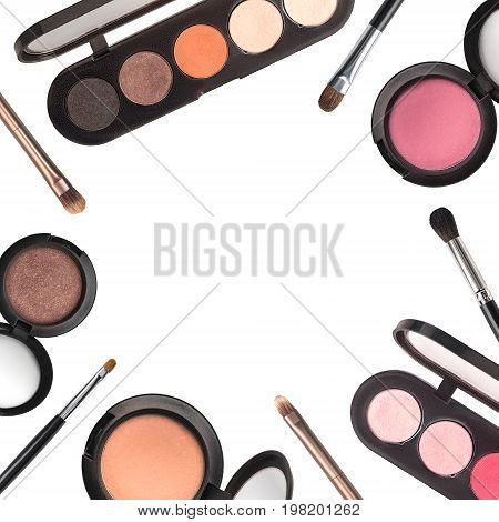 Set of eyeshadows and makeup brushes isolated on white.