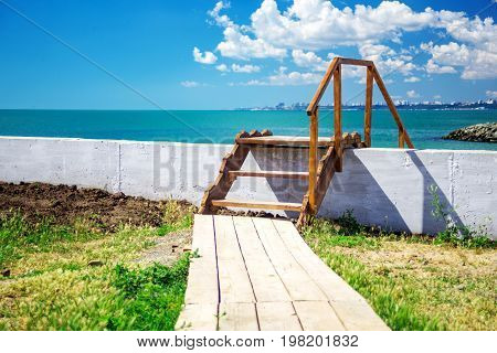 Wooden stairway to beautiful tropical beach. landscape