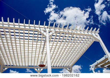 Wooden beach canopy. Natural light. sunbathe. wooden levels against the sky