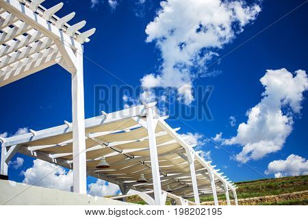 Natural light. sunbathe. wooden levels against the sky. Wooden beach canopy.