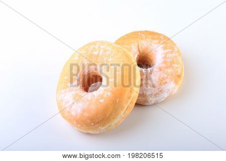 Homemade Doughnuts with Jelly filled and powdered sugar isolated on white background. Selective focus