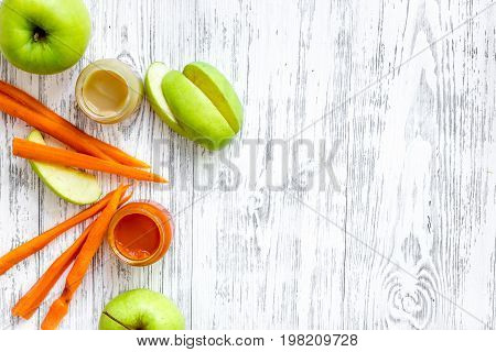 Preparing baby food. Puree on light wooden table background top view.
