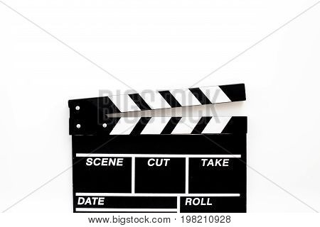 Filmmaker accessories. Clapperboard on white background top view.