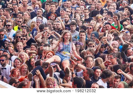 Kostrzyn Poland - August 03 2017: People having fun at a concert on the 23rd Woodstock Festival Poland one the biggest open air festivals in the world.