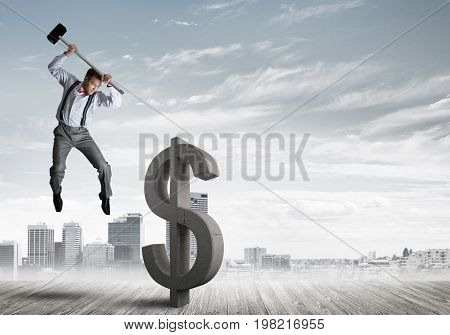 Young furious businessman going to crash with hammer stone dollar symbol. 3D rendering.