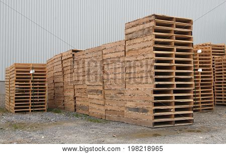shipping pallets stacked warehouse packaging business transport platform