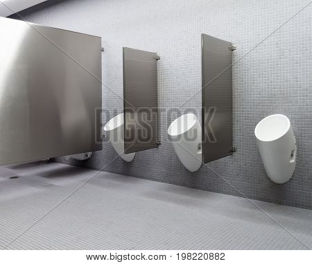 Interior of a modern men's public restroom with urinals