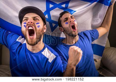 Israeli fans holding the national flag