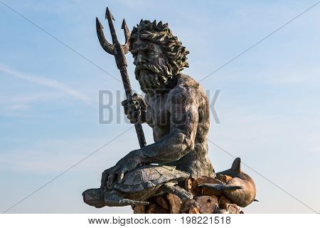 VIRGINIA BEACH, VIRGINIA - JULY 13, 2017:  The 34-foot bronze King Neptune statue located on the oceanfront boardwalk and sculpted by Paul DiPasquale.