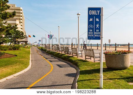 VIRGINIA BEACH, VIRGINIA - JULY 13, 2017:  Sign marking the bike path which parallels the oceanfront boardwalk.