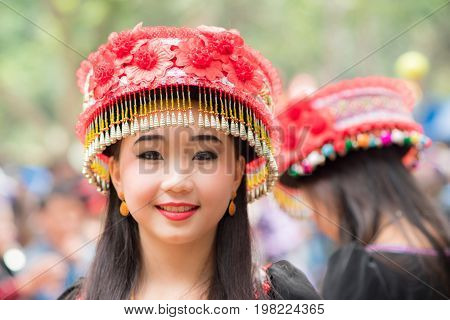 Luang Prabang, Laos - December 20, 2015: A woman of local mountaineer tribe 'Hmong' is dressing with traditional costume in Luang Prabang, Laos.