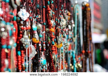 Traditional decoration necklaces in Tibet market place background