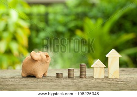 Piggy bank saving money concept growing business The concept of financial savings to buy a house.