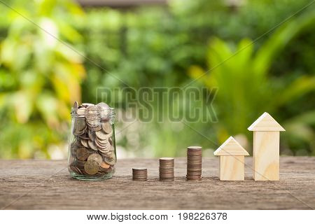 Money jar concept of real estate investments Home insurance Savings plans for housing The concept of financial savings to buy a house.