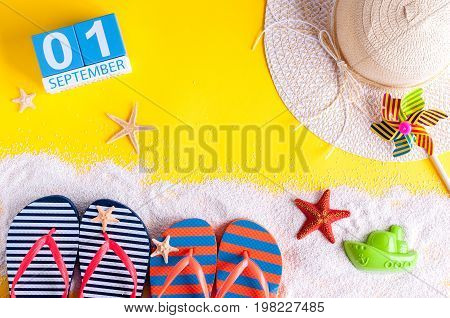 1st September. Image of september 1, calendar on yellow summer background with beach vacation accessories. Back to school concept.