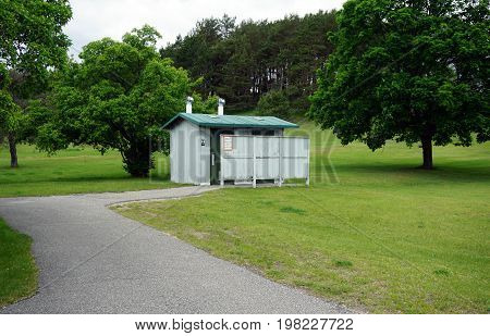 TUSTIN, MICHIGAN / UNITED STATES - MAY 31, 2017: Travelers on US Highway 131 may use the outhouse in the Tustin Rest Area and Scenic Overlook.