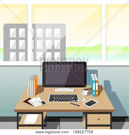 Organization of the workplace in an office at a computer desk. Office workplace at noon.