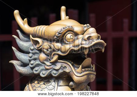 Bronze dragon head sculture at the entrance of a buddhist temple, Chengdu, China