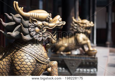 Two bronze dragon scultures at the entrance of a buddhist temple, Chengdu, China