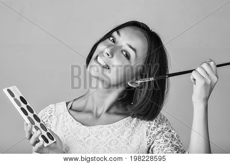 Woman With Paints