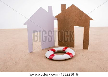 Little Model Life Preserver And  Paper Houses