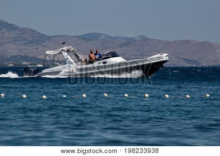 Vodice, Croatia, July 4, 2017, people riding on the boat with Yamaha engine