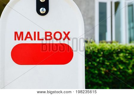 Close up of the mail box (or post box) is a box outside a person's house where letters are put.