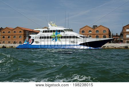VENICE ITALY - JUNE 10 2017: View of the catamaran ferry Prince of Venice moored along the Giudecca Canal in Venice Italy on a sunny afternoon. Part of the Adriatic Lines group of ferries it transports passengers across the Adriatic Sea between Venice and