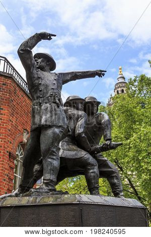 LONDON, GREAT BRITAIN - MAY 13, 2014: The National Firefighters Memorial is a memorial composed of three bronze statues depicting firefighters in action at the height of World War II.