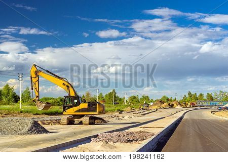 Crawler Excavator digging bucket on construction of high-speed bypass road around Krasnoe Selo Saint Petersburg. Heavy machine equipment for excavation works at civil industrial construction. Russia