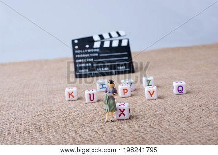 Letter Cubes Beside A Director Clapper Board