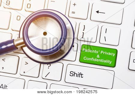 Stethoscope with written Patients' privacy and confidentiality on coumputer keyboard.