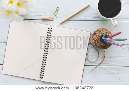 Modern white office desk top wood table with notebook notepad and other supplies. Top view with copy space on white background. Top view flat lay.