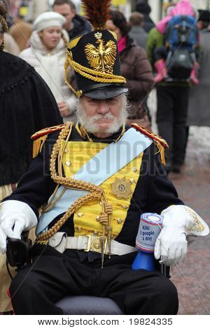 ROCHESTER CITY, KENT, ENGLAND - DEC 11:  Unidentified glderly gentleman in wheelchair wears uniform for annual Dickens Festival in Rochester, Kent, England on December 11, 2010.