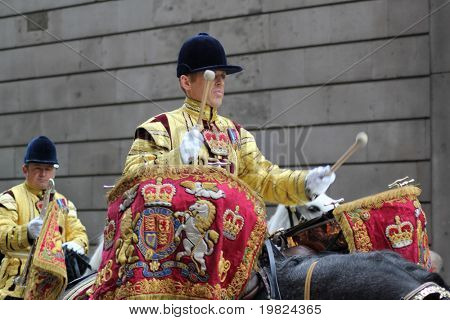 LONDON, ENGLAND - NOV. 12: Costumed soldier plays kettle drums on horseback in Lord Mayor's Show on 12 November 2010. The Lord Mayor's Show is an 800-year-old annual event in London.