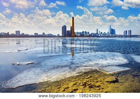 Ice of Han river and cityscape in winter Seoul in South Korea.