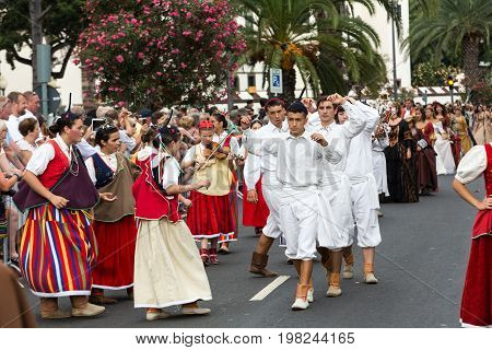 FUNCHAL PORTUGAL - SEPTEMBER 4 2016: Dancers with local costumes demonstrating a folk dance during the Madeira Wine Festival in Funchal on the Madeira Portugal.