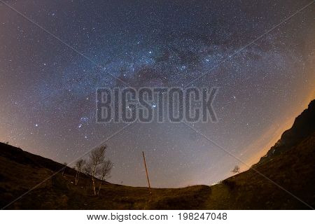 The Starry Sky And Milky Way Captured On The Alps By Fisheye Lens With Scenic Distortion And 180 Deg