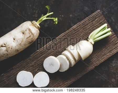 Radish and chopped radish on wooden