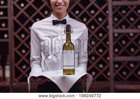 Sommelier With Wine In Cellar