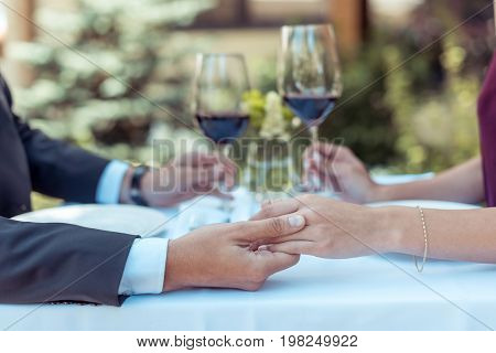 Couple Clinking Glasses On Date