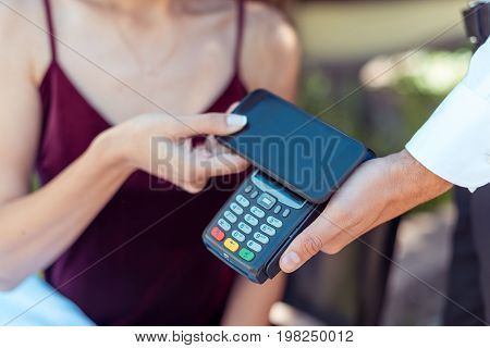 Woman Paying With Nfc Technology