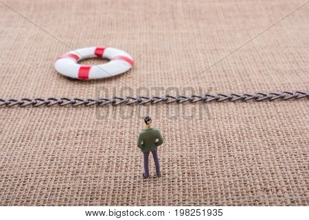 Figurine And Life Preserver A Chain In The Middle