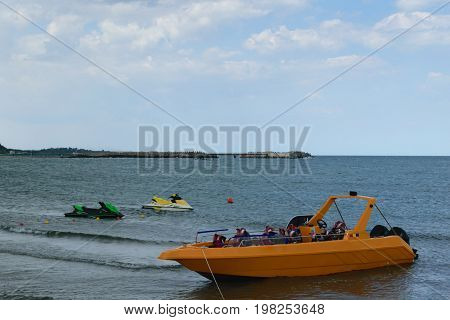 yellow power sport tourist boat jet skis at the Black Sea