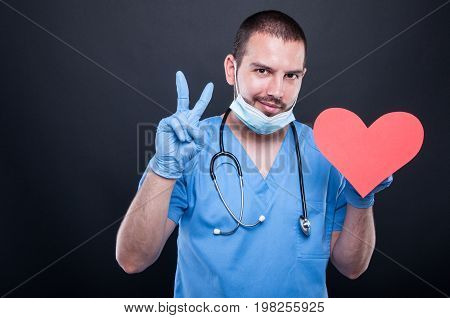 Cardiologist Holding Red Heart Shape Showing Peace