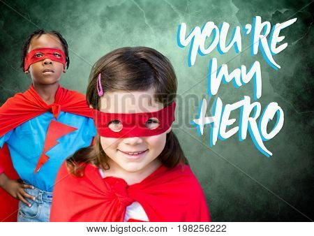 Digital composite of You're my hero text with Superhero kids in front of green background